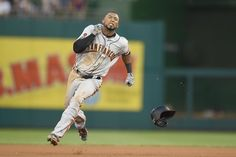 Eduardo Nunez #10 of the San Francisco Giants runs to third for a triple in the forth inning during a baseball game against the Washington…