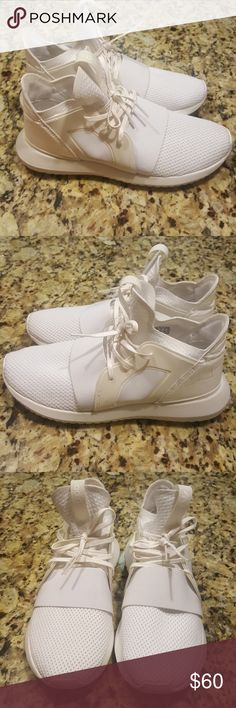 WOMENS ADIDAS TUBULAR DEFIENT The shoes' outsole is inspired by the inner tube of inflatable tires. These women's Tubular shoes emerge with a streamlined look. Built with a stretchy jersey upper for a sock-like fit, they have a reflective material on the