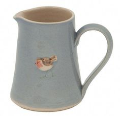 Jane Hogben Robin Small Jug Blue ~ matches the mug Upholstered Swivel Chairs, Outdoor Dining Chair Cushions, Arm Chairs, Folding Chairs, Ceramic Mugs, Ceramic Art, Childrens Rocking Chairs, Different Forms Of Art, Patterned Armchair