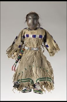 Culture/People:Northern Tsitsistas/Suhtai (Cheyenne) Object name:Female doll Date created:circa 1880 Place:Wyoming; USA Media/Materials:Slate, wood, deerhide/deerskin, hide, horsehair, glass bead/beads, metal cones Techniques:Carved, sewn, lazy/lane stitch beadwork, overlay beadwork, loom beadwork Collection History/Provenance:Said to have been collected by Mr. Fowler between 1880 and 1885; donated to MAI in 1961 by Mr. and Mrs. William R. Morgan on behalf of Justin King Morgan…