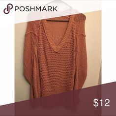 Loose knit oversized pink free people sweater Loose knit & loose fit. The color is kinda hard to describe but it's that nice muted pink that was everywhere in the early 90's. V-neck. I think it's a size medium but the tag was itchy so i cut it out. Free People Sweaters V-Necks