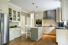 A Light and Airy Eat-In Kitchen Cabinetry: Crystal with Custom finish| Countertops: Pietra Del Cardosa | Backsplash: Grey SubwayTile | Designer: Ron Fisher | Location: Clinton, CT | The Kitchen Company |