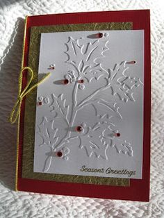 Another quick but elegant cuttlebug card, this one using the Holly folder.  Just a few red adhesive jewels, some gorgeous textured paper (t...