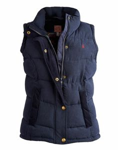 Joules HIGHAM Womens Gilet, Marine Navy. Perfect for a country ramble, dash to the shops or to pack away for a city escape. The latest version of our classic gilet is here to take you through the season in perfectly practical style. Heavily padded for improved warmth and with a stunning floral lining for increased style.