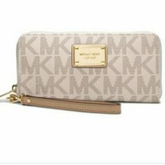 "MK Logo Zippy Clutch Authentic Michael Kors wallet/wristlet in vanilla/luggage with removeable 7"" strap. In excellent slightly used condition. Measures 7.5"" x 6"". Michael Kors Bags Clutches & Wristlets"