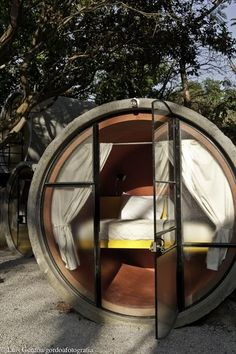 Concrete pipes transformed into rooms.