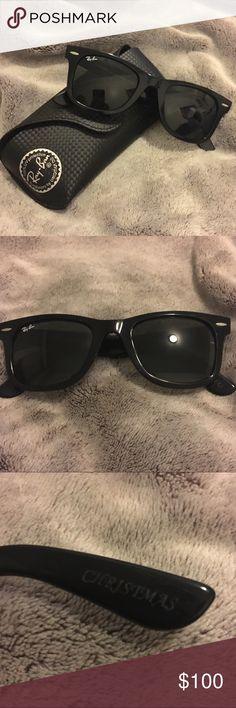 Ray-Ban Classic Wayfarer Sunglasses Black ray ban wayfarer glasses. Brand new only worn once. Comes with case and cleaning cloth. Has engraving on either ear piece but not noticeable at all. Ray-Ban Accessories Sunglasses