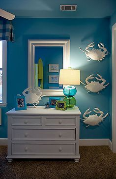 love the crisp white with the bright blue wall and esp. love the crab line up