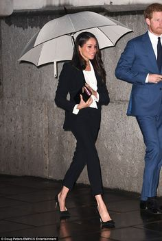 Meghan Markle, 36, looked stunning tonight as she stepped out in a tailored McQueen trouse...