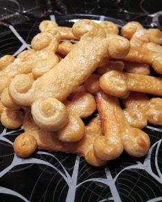 Breadstick Bones - refrigerated bread sticks shaped into bones - great for Halloween - top with garlic butter for a fun side for pasta.