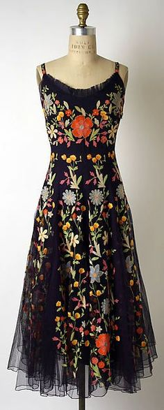 I'm still feeling the love for embroidery that summer always brings out in me. This one is especially eye-catching with a dramatic use of bold color on black. And it's from the 1940&#82…