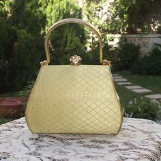 Small gold vintage Mad Men evening rhinestone purse with chain. $95.00, via Etsy.