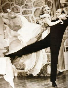 Fred Astaire and Ginger Rogers.  Mom Looooved Ginger's dresses!
