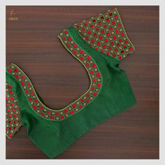 Crafted with cut work and beads, this blouse has an amazing colour and a traditional cut. DM us for more details. Kerala Saree Blouse Designs, Cutwork Blouse Designs, Patch Work Blouse Designs, Hand Work Blouse Design, Wedding Saree Blouse Designs, Best Blouse Designs, Simple Blouse Designs, Stylish Blouse Design, Mirror Blouse Design