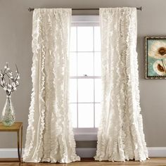 Flowing hand crafted vertical ruffles turn the ordinary into a beautiful window…