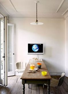 In Livingetc magazine article, the kitchen farmhouse table is shot with Jenna's husband Vincent Mazeau and their son Beckett. The online photo is just the table.