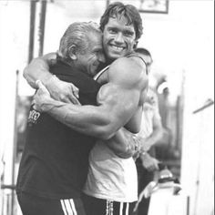 Arnold and Joe Gold...Golds gym founder.