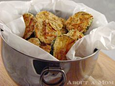 """Lightened Up Zucchini Chips recipe --- """"Baking the zucchini slices on a wire rack exposes all sides to the oven's heat, resulting in a crisp chip. These oven baked zucchini chips are just as crisp and flavorful as the fried variety."""""""