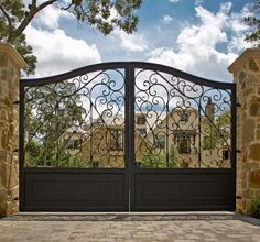 Residential Driveway Gates with Mediterranean Landscape Also Brick Driveway Entry Gate Filagree Jerkinhead Roof Metal Gate Stone Pillars Wall Lantern Wrought Iron Gate Wrought Iron Lighting Fixture Wrought Iron Driveway Gates, Brick Driveway, Driveway Entrance, Front Gates, Front Yard Fence, Entrance Gates, Iron Garden Gates, House Entrance, Wrought Iron Gate Designs