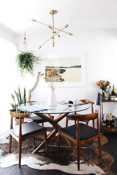 eclectic dining room with gold light fixture