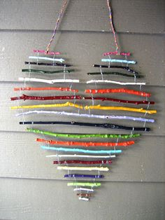art for the cottage porch - painted sticks wired together and hung with electrical wire  DIY....what if they were tied together with cotton strips for a country woven look? hmmm