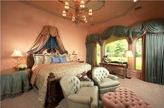 A lovely bedroom with a luxurious canopy.