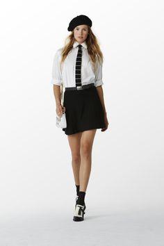 POLO Women Spring 2015 collection: White broadcloth shirt, black knit skirt, white vacchetta crossbody with lock, and black/cream calfskin spectator sandal