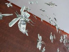 A swarm of locusts made from dollar bills!