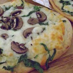 Allie's Mushroom Pizza Recipe Main Dishes with baked pizza crust, olive oil, sesame oil, fresh spinach, shredded mozzarella cheese, fresh mushrooms