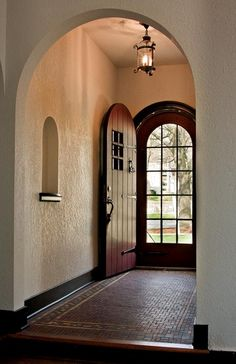 arched entry . including a divided light storm door & arched niche . period tudor home, Geneva IL