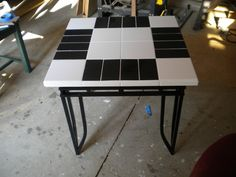 Old glass top end table transformed to a beautiful tile top table.