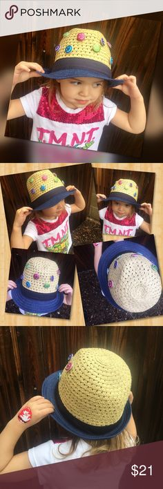 Smiley 😊 Hat Smiles on chins up!  Glittery smiley faces adorn the face of the darling hat. Blue trim, straw hat made of 89% paper, 11% polyester. Adorbs that will hold back sunshine, or keeping the little head warmer this fall. Add to any ensemble for an adorable look! Our little model said she likes it because it's co-pro-ball (translation: comfortable). Accessories Hats