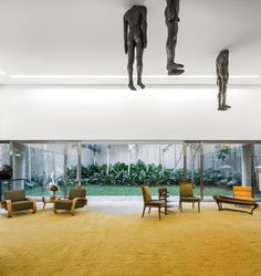 I've figured out what my living room is missing. Naked headless people hanging from the ceiling!