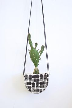 Handmade pottery hanging wall planter for home use.