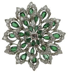 Emerald and diamond brooch, featuring 28 pear-shaped emeralds, totalling approximately 12 carats and 119 diamonds, weighing approximately 5.8 carats, set in platinum, late 1950's-early 1960's. Oscar Heyman and Bros.