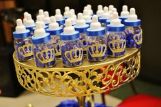Baby bottle favors at a royal prince baby shower party! See more party planning ideas at CatchMyParty.com!