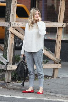Comfy clothes cute on Sienna Miller. A sweater, sweats and flats. It's all in the fit.