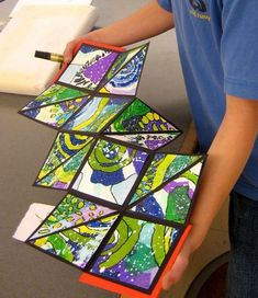 """These small, square books """"explode"""" into a series of square and triangular pages when you open them. Each student constructed their own book with decorative papers, cardboard, ribbon, and construct…"""
