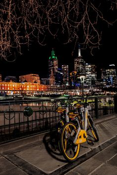 Cycling, besides walking, is encouraged by Melbourne's city council as a healthy and environmentally friendly transportation mode around the city. Shiny new yellow bikes from a new bicycle ride-sharing company have recently joined Melbourne's iconic blue shared bicycles around the city centre. August 2017. #melbournecity #victoria #australia #bicycles #citycentre #nightphotography