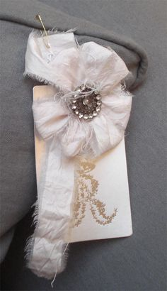Love this torn look. I have some old vintage rhinestone buttons. Gonna make one of these.