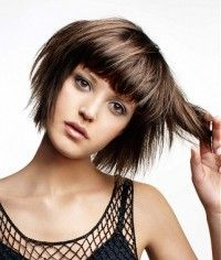 Bob with blunt, heavy bang. I could never get away with this cut but I still love it!