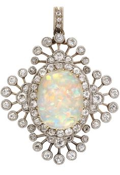 An Edwardian opal and diamond brooch  An Edwardian opal and diamond brooch, the oval cabochon-cut opal measuring approximately 14.3 x 11mm, yellow gold claw-set to the centre of an old-cut diamond cluster surround, all within a border of old-cut diamond sprays forming a quatrefoil design, all diamonds millegrain-set in silver to a yellow gold mount, with detachable brooch fitting and diamond-set pendant loop, gross weight 8.7 grams, circa 1900.
