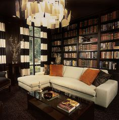 Home library with book page chandelier and wide striped curtains
