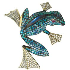 Frog brooch in 18-karat white and yellow gold with opals, moonstones and pink sapphires by Gregore Morin, Gregore Joailliers, Santa Barbara, Calif., for the 2009 AGTA Spectrum Awards