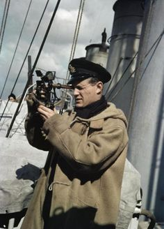 theworststreetjournal: A British Naval Officer with a sextant, aboard a former…