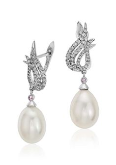Love on fire, these flame-inspired earrings are crafted in 18k white gold with pavé diamonds and luminous white freshwater cultured pearl drops.