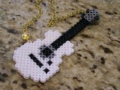 ROCK ON Guitar necklace white black perler beads, made by 14 year old Perler Bead Designs, Hama Beads Design, Diy Perler Beads, Pearler Bead Patterns, Perler Bead Art, Perler Patterns, Pearler Beads, Art Perle, Pixel Beads