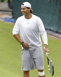 Rafael Nadal of Spain smiles during a training session at the Wimbledon tennis championships in London, Sunday, June 23, 2013. The Championships start Monday, with defending men's champion Roger Federer of Switzerland attempting to win the title for the eighth time. (AP Photo/Kirsty Wigglesworth)