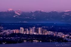 Bellevue from Seattle with the cascades glowing in pink!