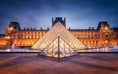 THE LOUVRE'S FAMOUS PYRAMID ENTRANCE to the Louvre Museum, Paris, France. Completed in 1989 by architect I. M. Pei, it has become a landmark of the city of Paris. Just Satan leaving his mark.